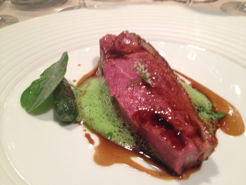 Aged duck, prefectly cooked, served with tarragon foam and pickled cucumber